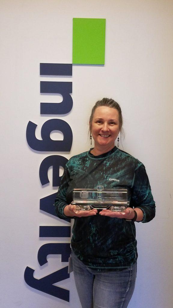 Arlene Brooks holding award